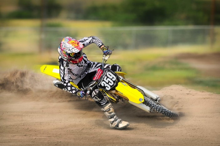 Motocross rider sliding into a turn