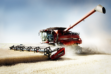 Red Case harvester cutting wheat