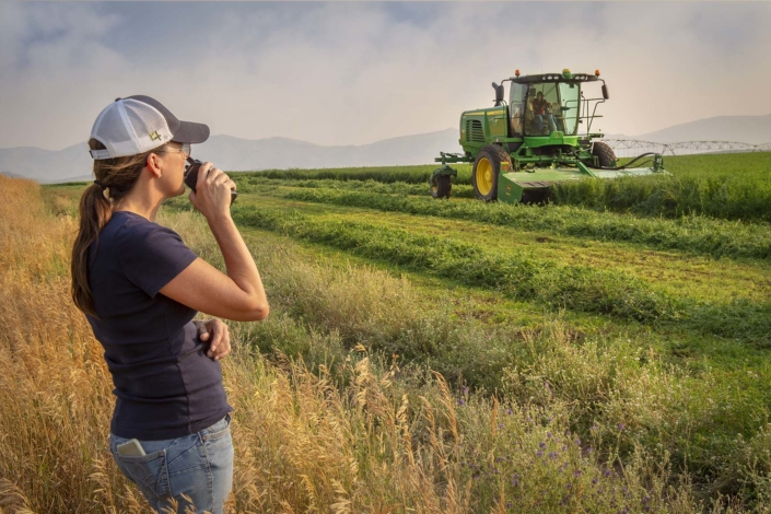 Corporate Photography. Farm manager directing the harvest.